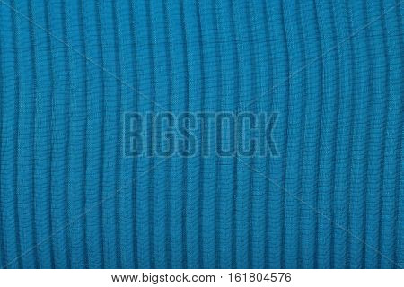 Black Pleated Transparent Caprone Cloth On A Blue Background