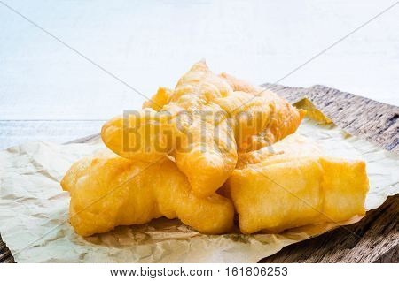 Chinese deep fried dough sticks on brown paper breakfast in Thailand