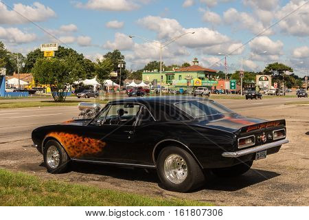 ROYAL OAK MI/USA - AUGUST 18 2016: A 1969 Chevrolet Camaro car and Woodward Avenue sign near Duggan's Irish Pub at the Woodward Dream Cruise. Woodward is a National Scenic Byway.