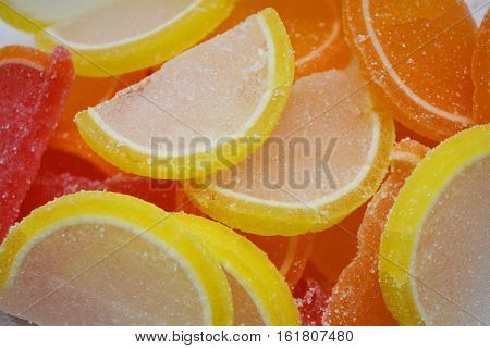 colorful slices of fruit jellies in sugar, colorful candied fruits