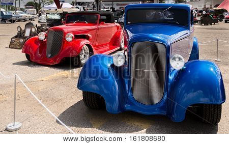 ROYAL OAK MI/USA - AUGUST 18 2016: Three Dodge hot rods at the Woodward Dream Cruise. Woodward is a National Scenic Byway.