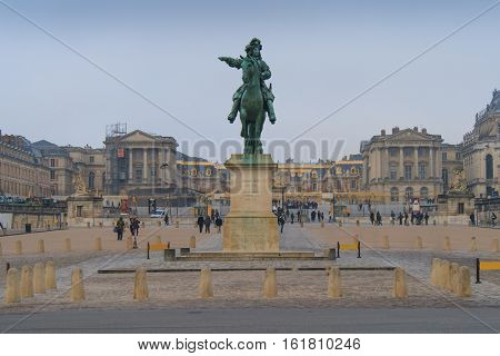 Paris, France - January 12, 2014. Welcome to Versailles. Equestrian statue of King Louis XIV by Pierre Cartellier and Louis Petitot, located in the entrance of Palace of Versailles.