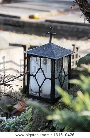 frozen old lantern in the nook at the cemetery