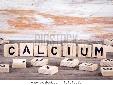 Calcium from wooden letters on wooden background.