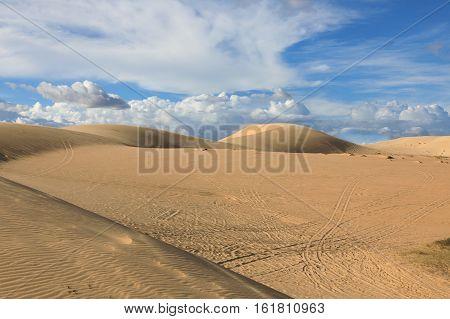 Deserted white sand dunes on the background of blue sky near Mui Ne place Vietnam