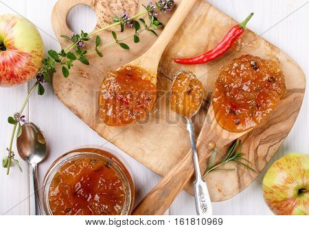 Chilli pepper apple jam with herbs. Top view.