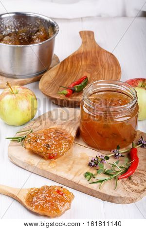 Hot chilli pepper apple jam with herbs