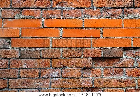 Texture of a wall with ancient and new bricks