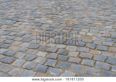 Cobblestone background texture. Cobbled street in France. Pavement.