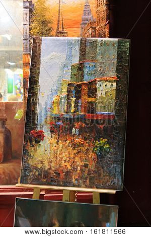 Paris, France, January 12, 2014. Painting of a rainy city at Montmartre