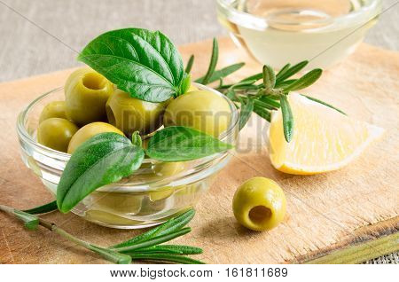 Glass Cup With Green Pitted Olives