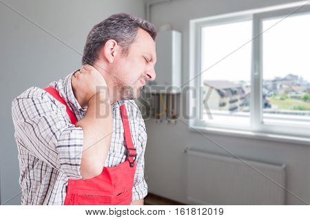 Tired Plumber With Neck Pain