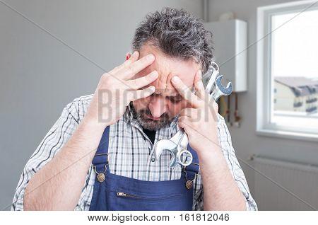 Sad Male Fitter Having Headache