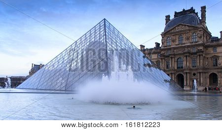 Paris, France, January 12, 2014. The Louvre art gallery and pyramid.