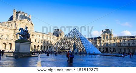 Paris, France, January 12, 2014. The Louvre palace and Louvre pyramid. Louvre Museum is one of the largest and most visited museums worldwide