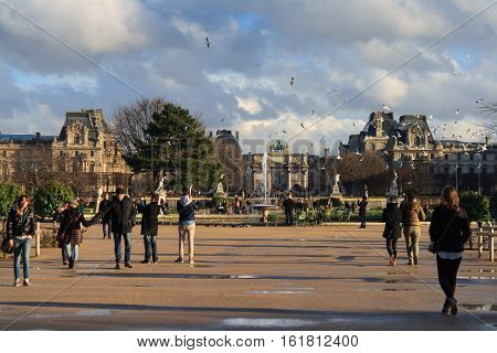 Paris, France, January 13, 2014. Incredible France. People enjoy their leisure time close to Arc de Triomphe du Carrousel and Louvre after the rain.