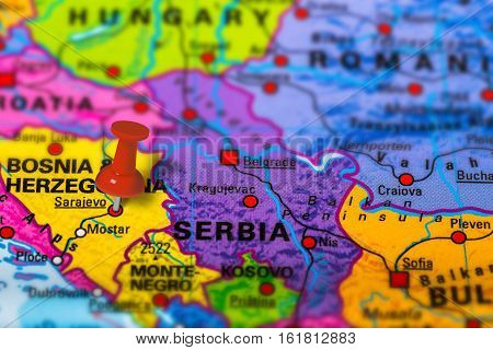 Sarajevo in Bosnia pinned on colorful political map of Europe. Geopolitical school atlas. Tilt shift effect.