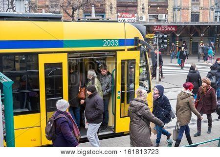 Yellow Budapest Tram And Passengers