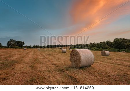 Sunset around bales of hay in the summer, near Burgas city, Bulgaria