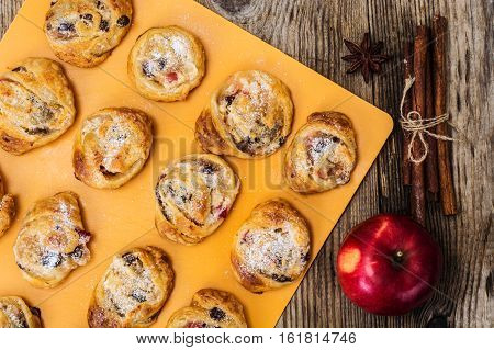 Cookies of puff pastry with apple jam and raisins. Studio Photo