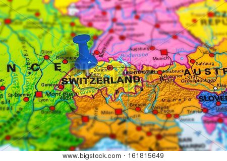 Bern in Switzerland pinned on colorful political map of Europe. Geopolitical school atlas. Tilt shift effect.