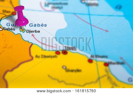 Djerba island in Tunisia pinned on colorful political map of Africa. Geopolitical school atlas. Tilt shift effect.