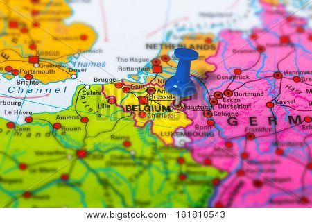 maastricht in Belgium pinned on colorful political map of Europe. Geopolitical school atlas. Tilt shift effect.