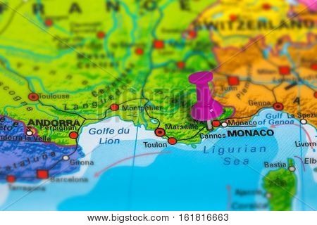 Cannes in France pinned on colorful political map of Europe. Geopolitical school atlas. Tilt shift effect.