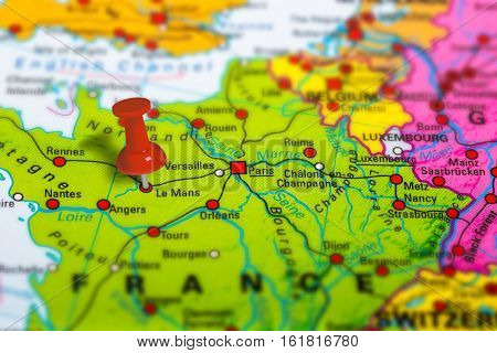 Le Mans in France pinned on colorful political map of Europe. Geopolitical school atlas. Tilt shift effect.