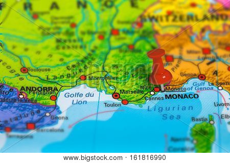 Monaco in France pinned on colorful political map of Europe. Geopolitical school atlas. Tilt shift effect.