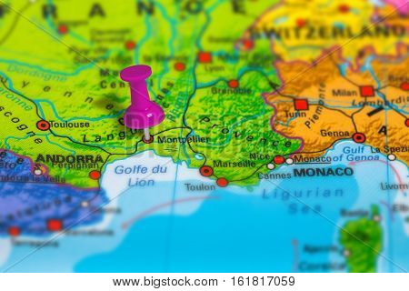 montpellier in France pinned on colorful political map of Europe. Geopolitical school atlas. Tilt shift effect.
