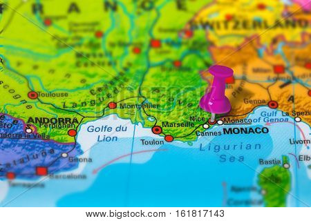 Nice in France pinned on colorful political map of Europe. Geopolitical school atlas. Tilt shift effect.