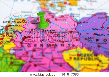 hannover in Germany pinned on colorful political map of Europe. Geopolitical school atlas. Tilt shift effect.