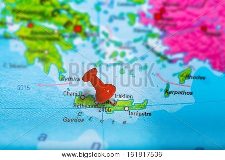 Iraklion in Greece pinned on colorful political map of Europe. Geopolitical school atlas. Tilt shift effect.