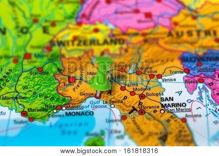 Genoa in Italy pinned on colorful political map of Europe. Geopolitical school atlas. Tilt shift effect. poster