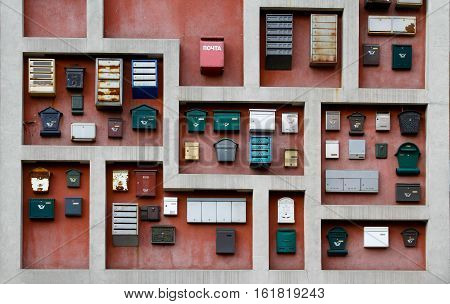 Different mailboxes decoration hanging on the wall