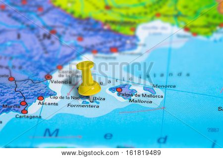 Ibiza in Spain pinned on colorful political map of Europe. Geopolitical school atlas. Tilt shift effect.