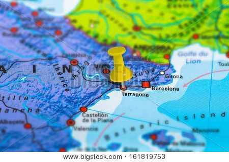 Terragona in Spain pinned on colorful political map of Europe. Geopolitical school atlas. Tilt shift effect.