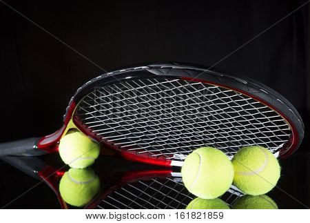 Tennis racket and two balls for playing tennis