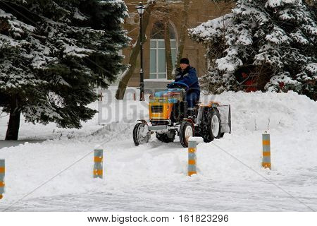 Volgograd Russia - January 07 2016: Snowplow cleans from the road snow in Volgograd