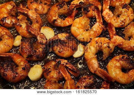 Shrimps with garlic in the pan. King size