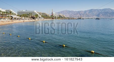 Relaxing atmosphere on central public beach of Eilat - famous tourist, resort and recreational city in Israel