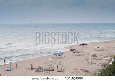 camping tents and shelters on the beach