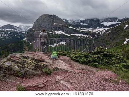 Woman Looks out Over Grinnell Lake on cloudy day
