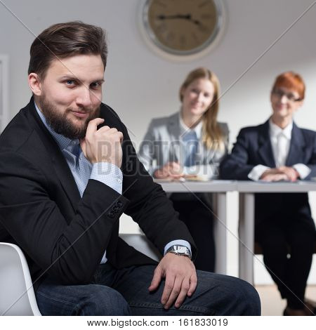 Elegant Smiling Businessman With Colleagues