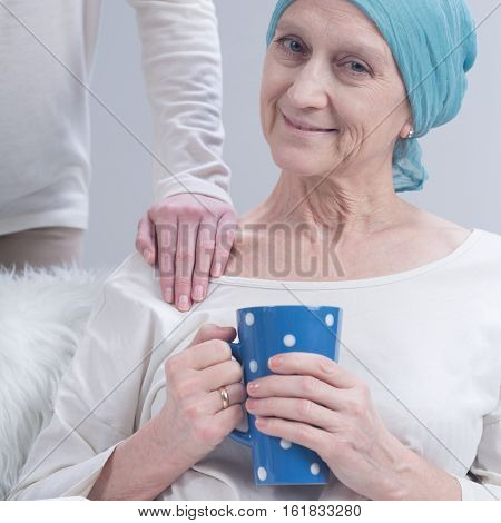 Oncology Patient And Person Holding Her Arm