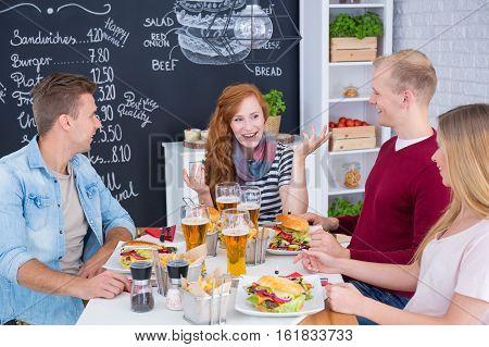 Friends Eating Hamburgers