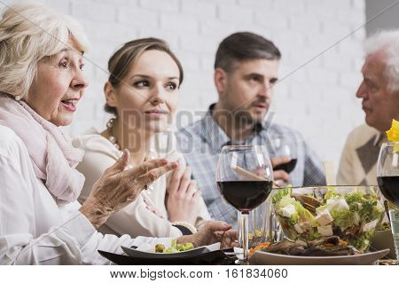 People Gossiping During Sunday Dinner
