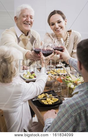 Family Raising Glasses With Wine