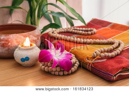 Orchids flowers and Rosary beads necklace on Silk cloth Thailand
